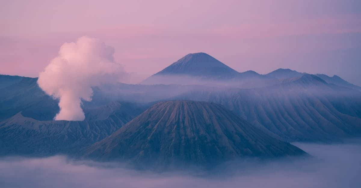 A view of a large mountain in the background with Mount Bromo in the background